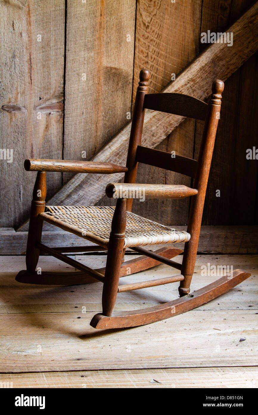A child's rocking chair waiting to be sat upon. - Stock Image