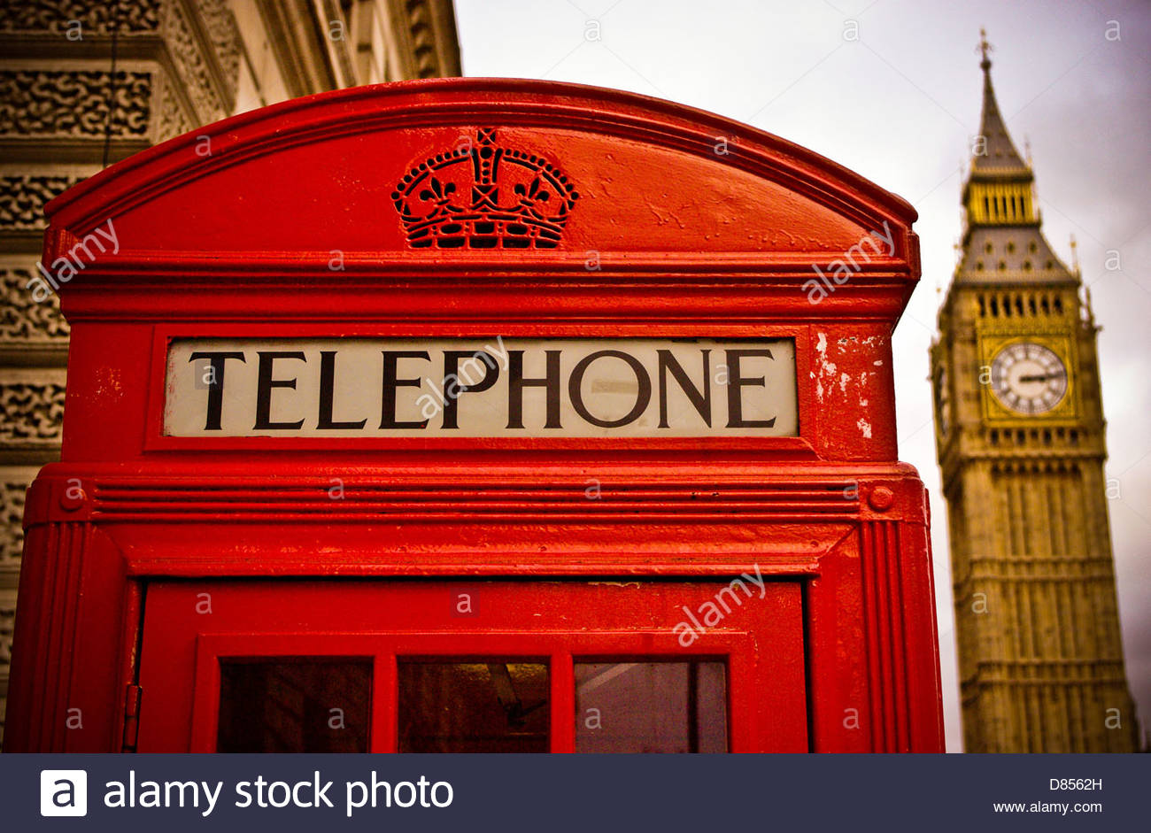 red telephone box london next to Big Ben clock Houses of Parliament whitehall - Stock Image