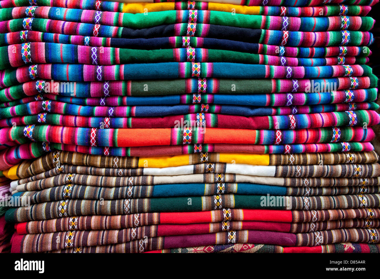 Textiles on sale in a market in Bolivia close to La Paz - Stock Image