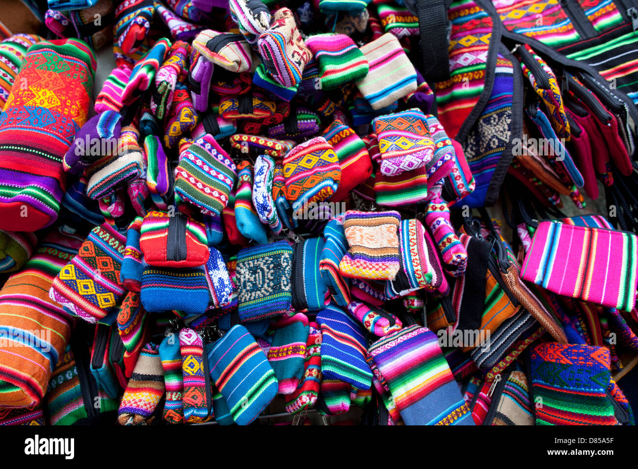 Textiles on sale in a market in Bolivia close to La Paz - Stock Image