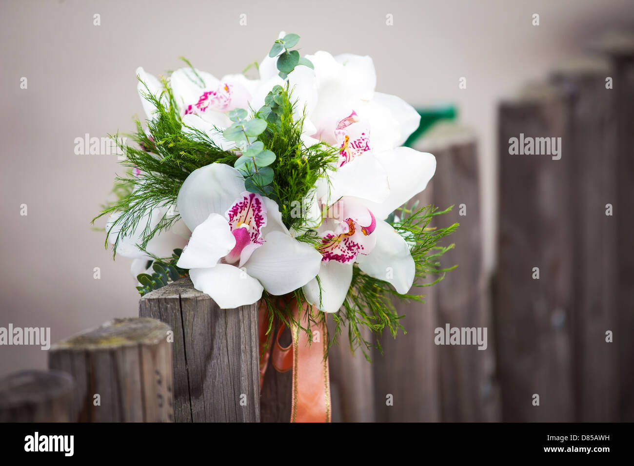 Wedding Bouquet With White Orchids On Rustic Country Fence Stock