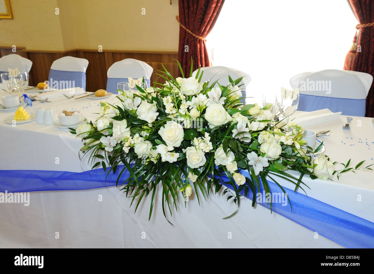 Head Table At Wedding Reception With Blue Ribbon Stock Photo