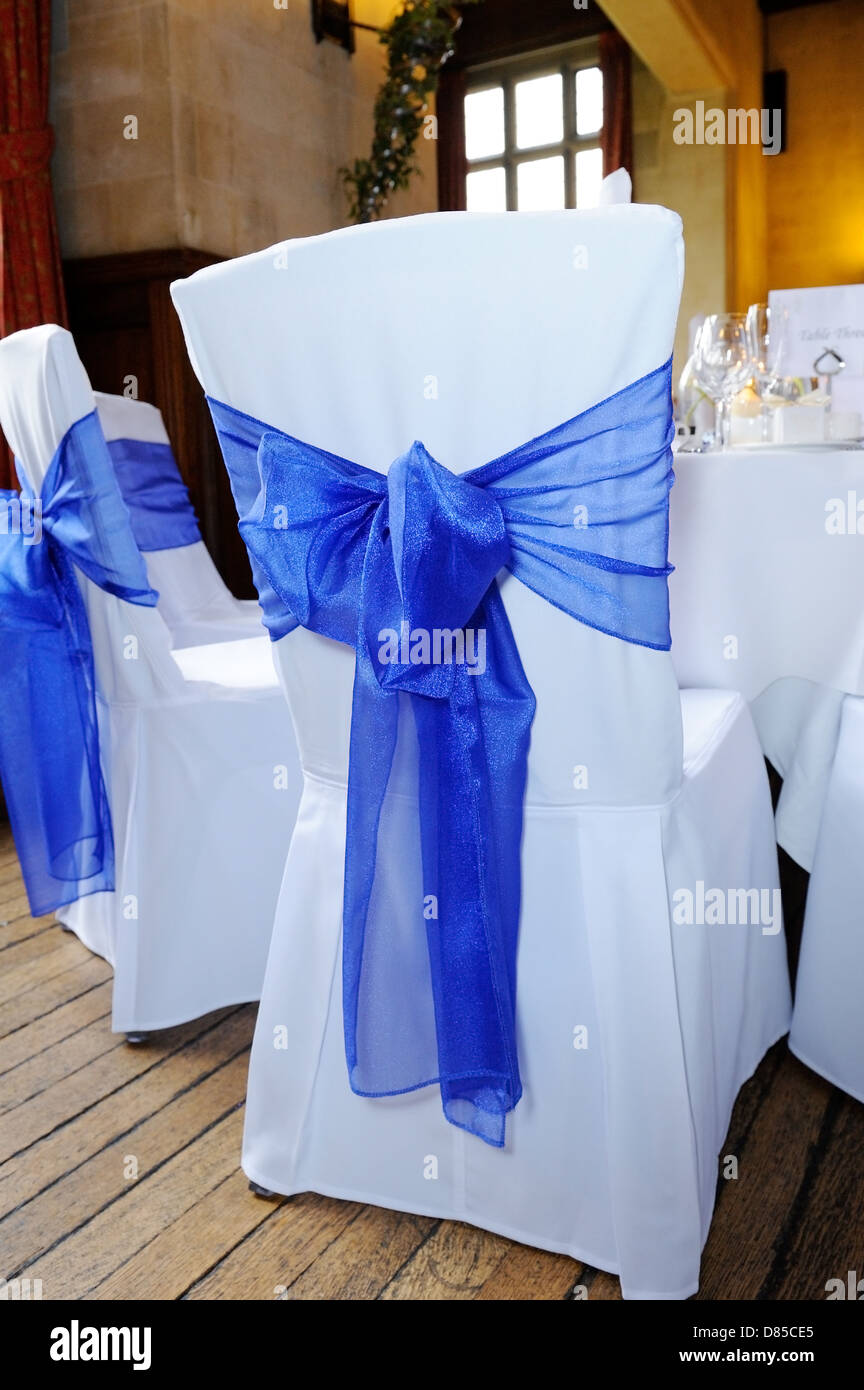 blue ribbon chair cover tied in bow at wedding reception stock photo