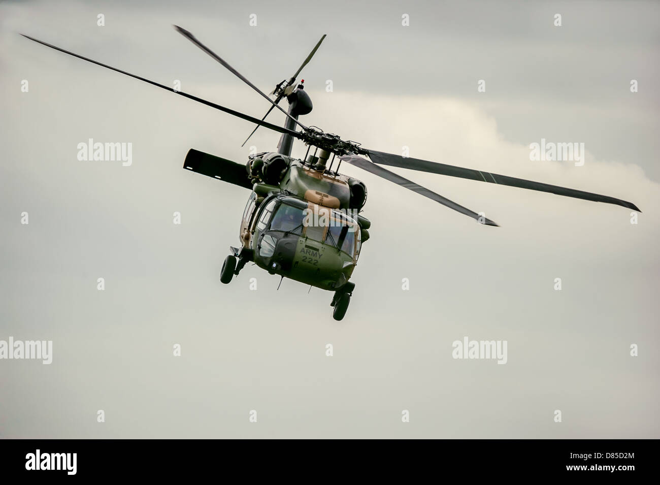 A menacing looking military helicopter goes through its paces at the Avalon Air Show in Australia. - Stock Image