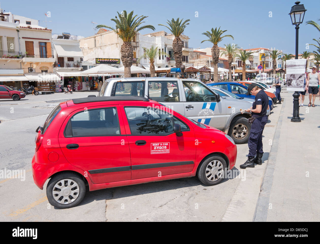 Traffic wardens or  police officers issuing parking tickets in the Cretan town of Rethymno - Stock Image