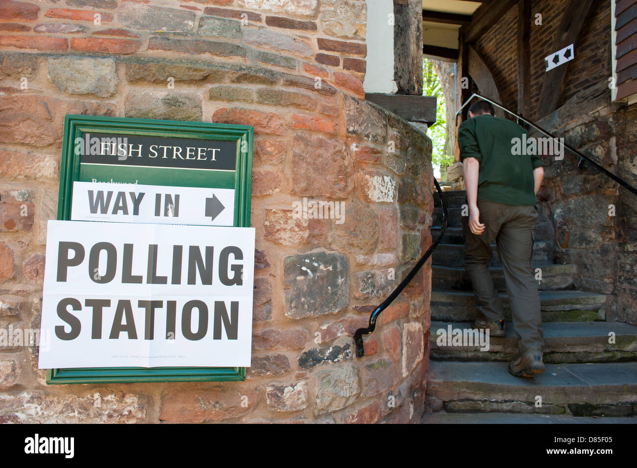 A man entering a polling station in Shrewsbury, Shropshire, England. - Stock Image