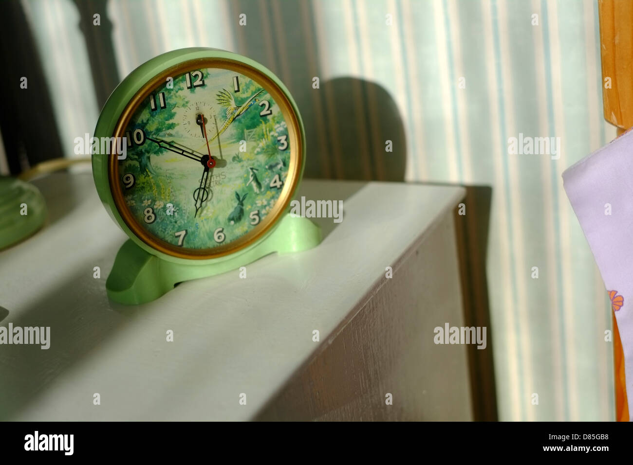 A vintage Smith Sectric alarm clock in the early morning sun. Stock Photo