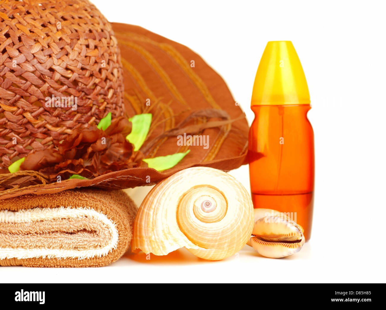 Beach items isolated on white background, straw hat, sunscreen oil, towel and seashell, still life, feminine accessories - Stock Image