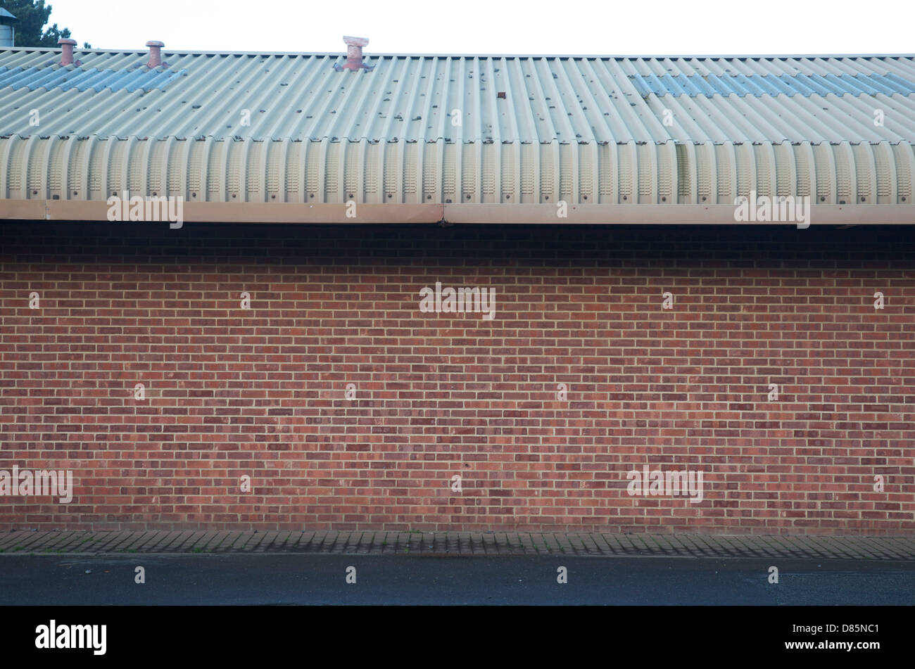 Brick Wall Side View Of Warehouse And Metal Roof