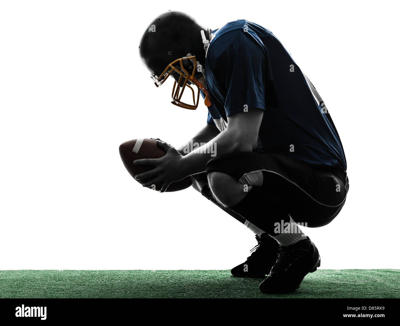 one  defeated american football player man in silhouette studio isolated on white background - Stock Image