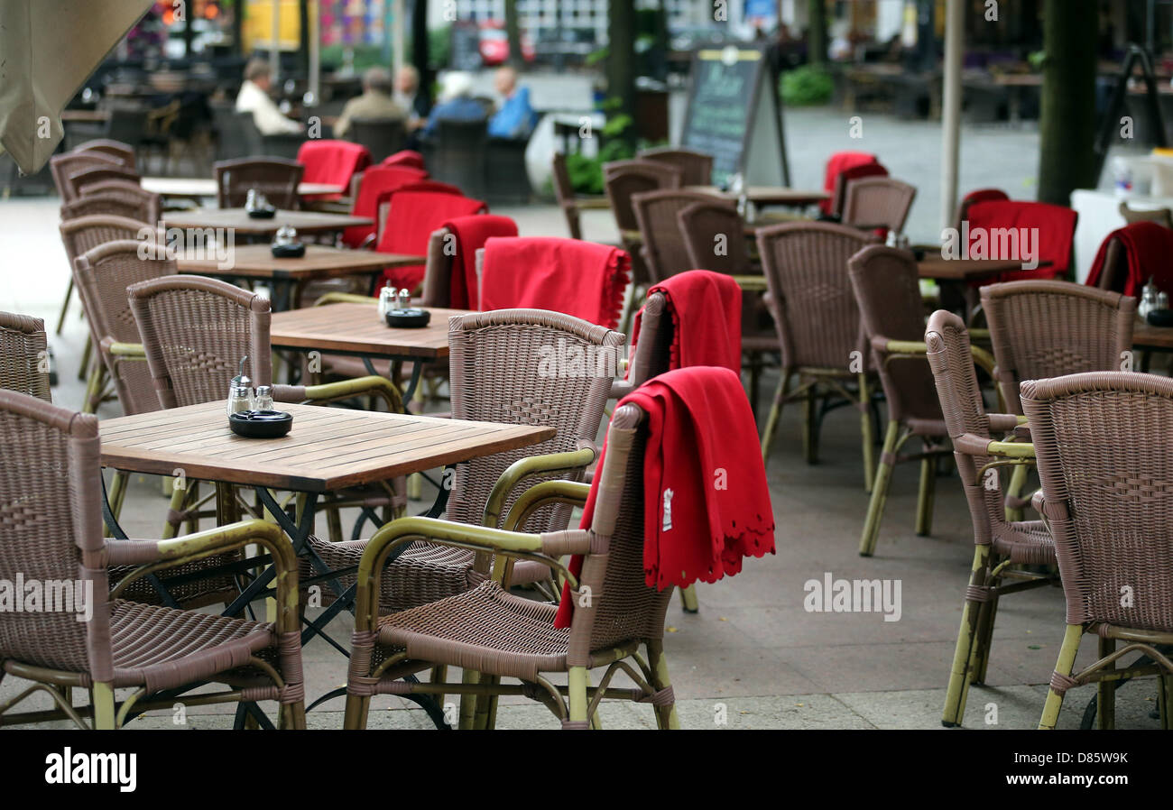 View of the empty tables and chairs of a restaurant at Wittenbergplatz in chilly weather in Berlin, Germany, 20 - Stock Image