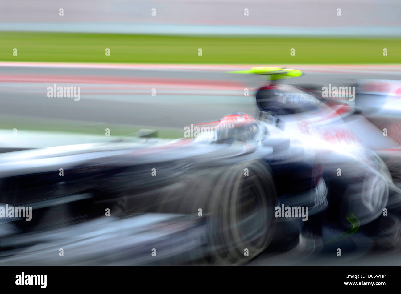 blurred Williams Formula One race car during the Spanish Formula One Grand Prix race 2013 - Stock Image