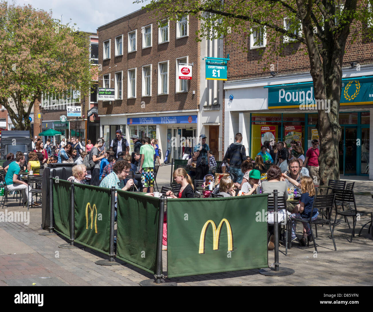 Mcdonalds Fast Food outside eating area Canterbury High Street Kent - Stock Image