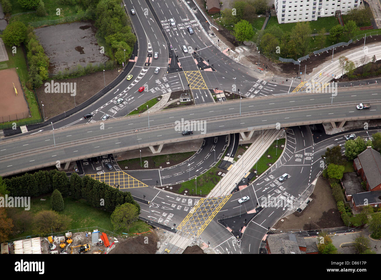 aerial view of a major roundabout junction with lots of road markings and a new tramway in Oldham - Stock Image