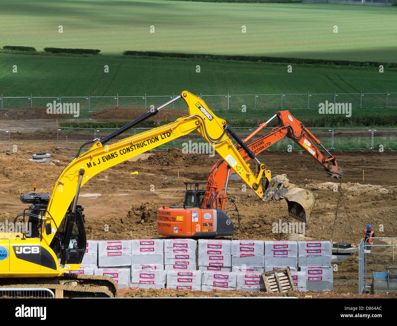 Heavy earth moving machinery preparing rural land for housing development, Grantham, Lincs - Stock Image