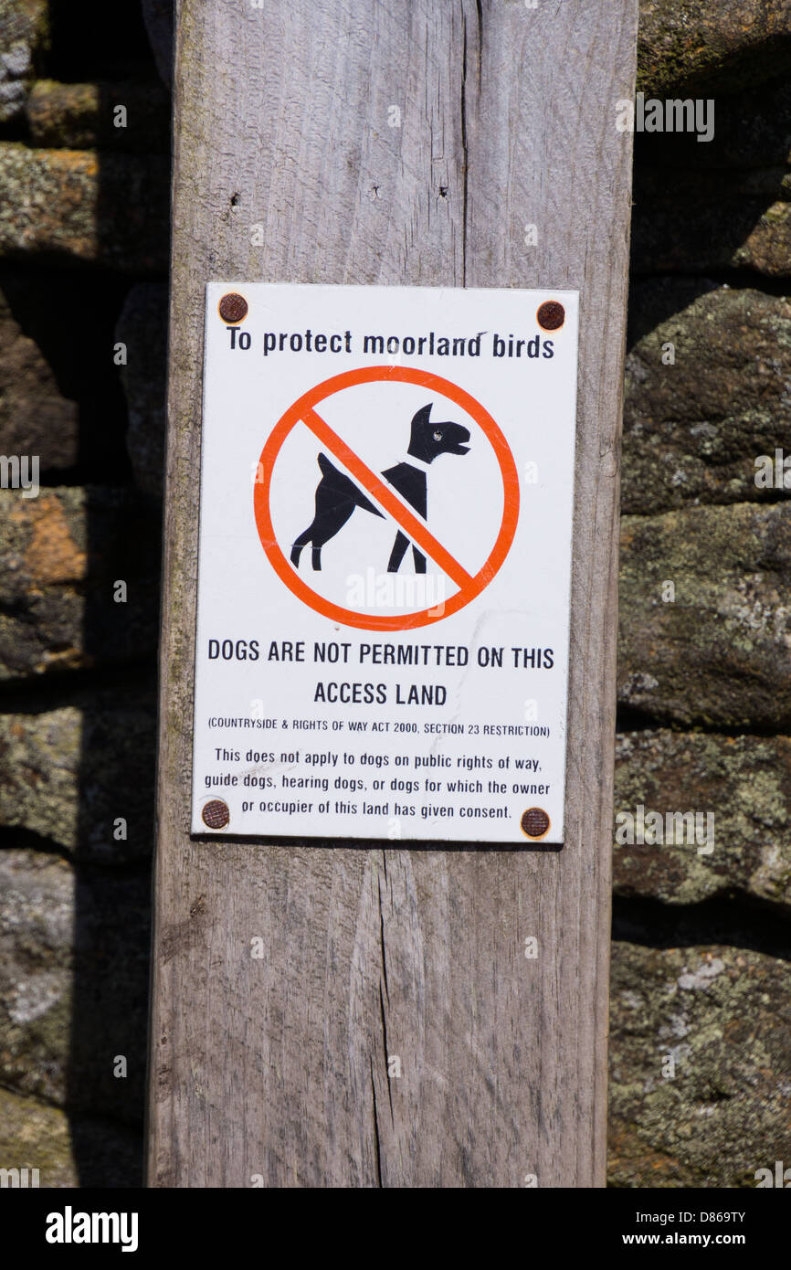 To protect moorland birds, dogs are not permitted on this land signpost. - Stock Image
