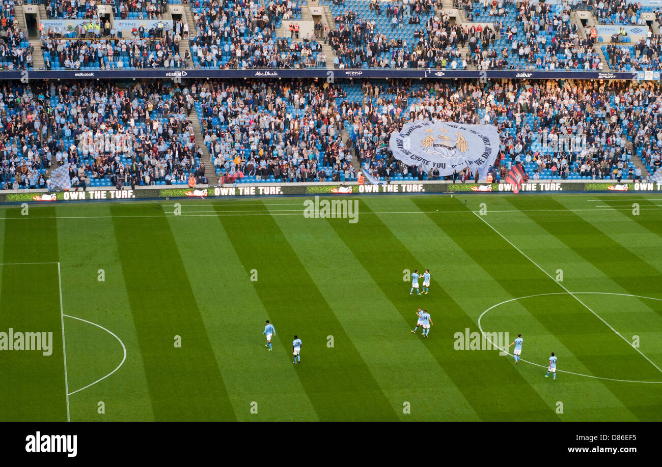 Manchester City players warming up for a home game at the Etihad Stadium - Stock Image