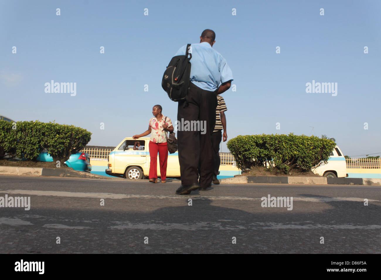 People walking on a Zebra Crossing Stock Photo