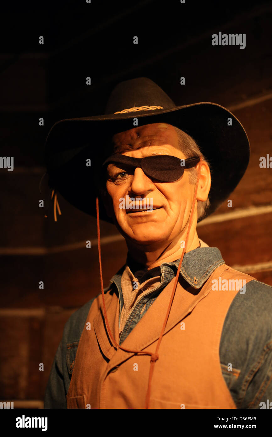 A wax figure of John Wayne. - Stock Image