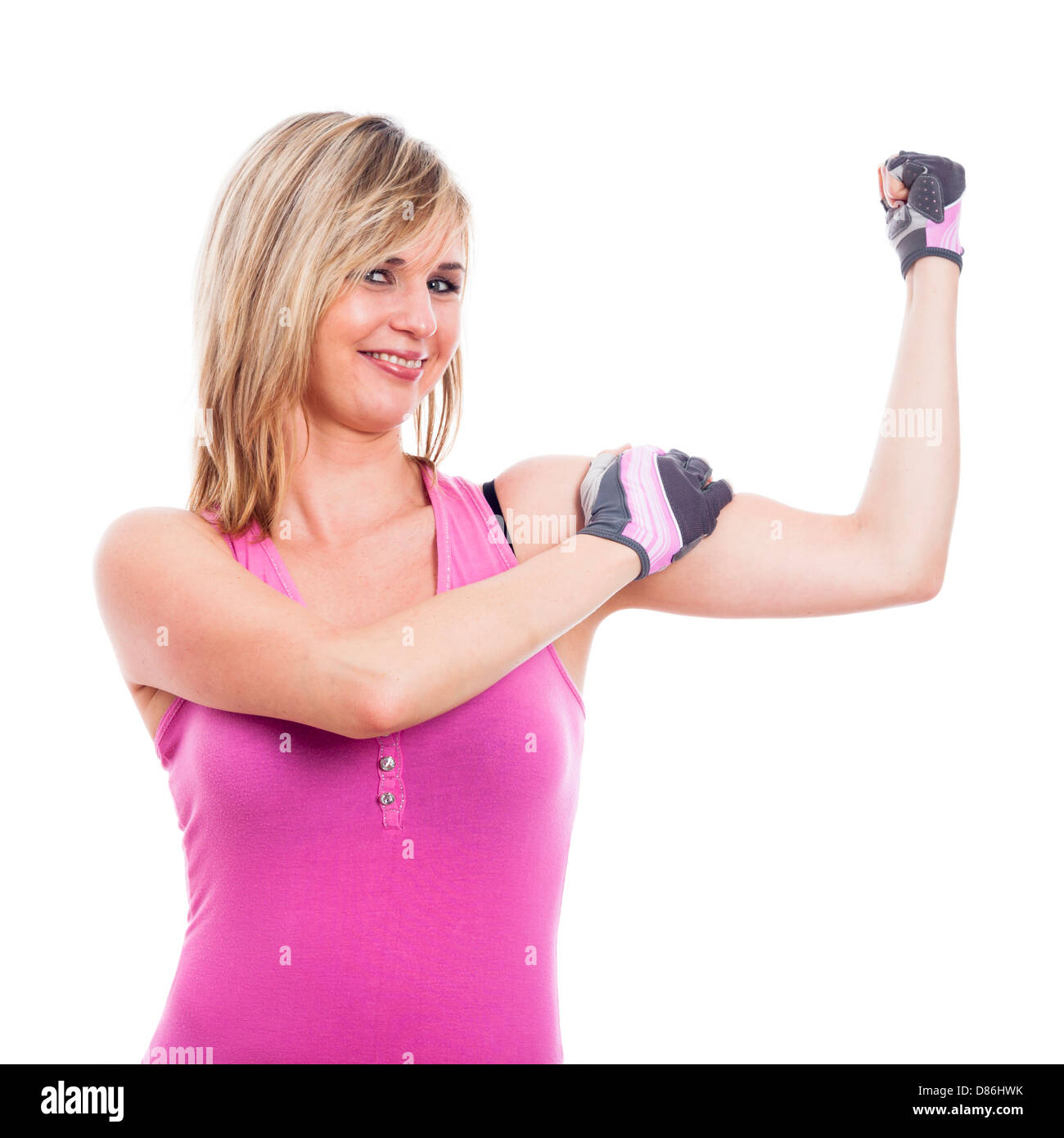 Happy fitness woman showing biceps, isolated on white background - Stock Image