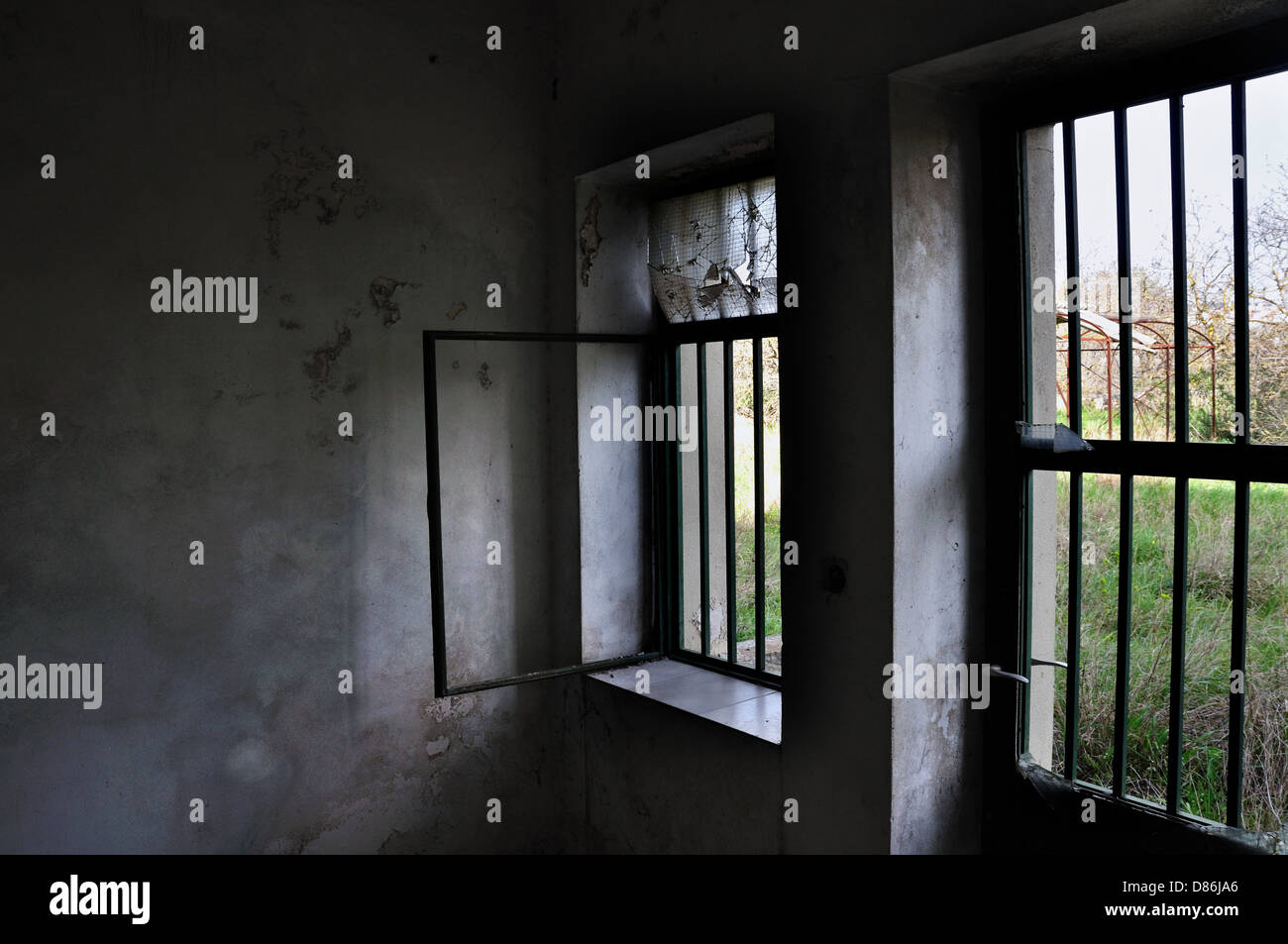 Barred door and windows in abandoned house interior. & Barred door and windows in abandoned house interior Stock Photo ...