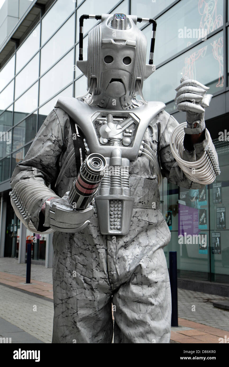 Fan of the British science fiction television series Dr Who dressed as Cyberman character. - Stock Image