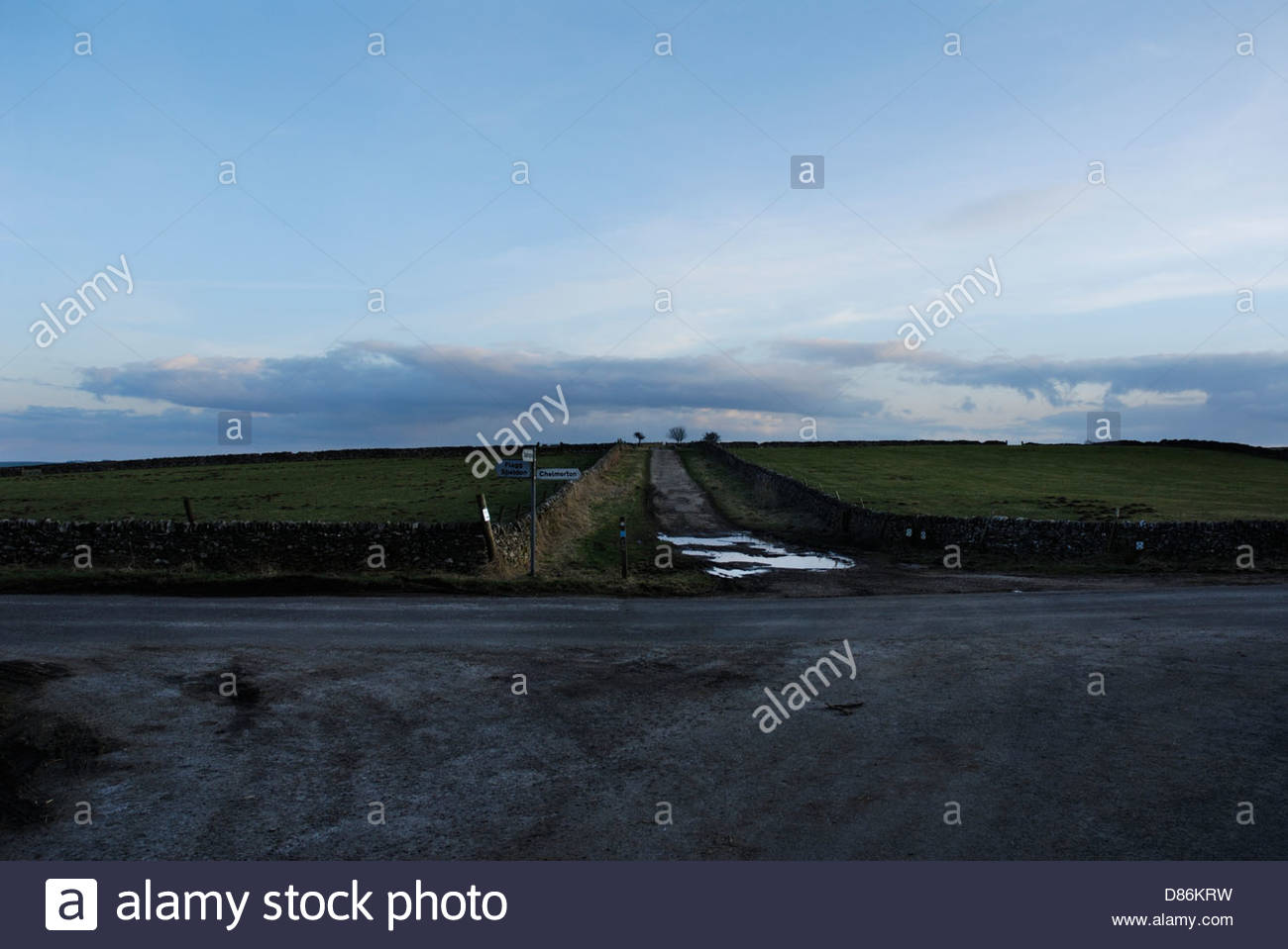 Sign to Chelmorton (Old Saxon Village), from Highstone lane,Beautifully serene with puddle,The Peak District,England,Britain,UK - Stock Image