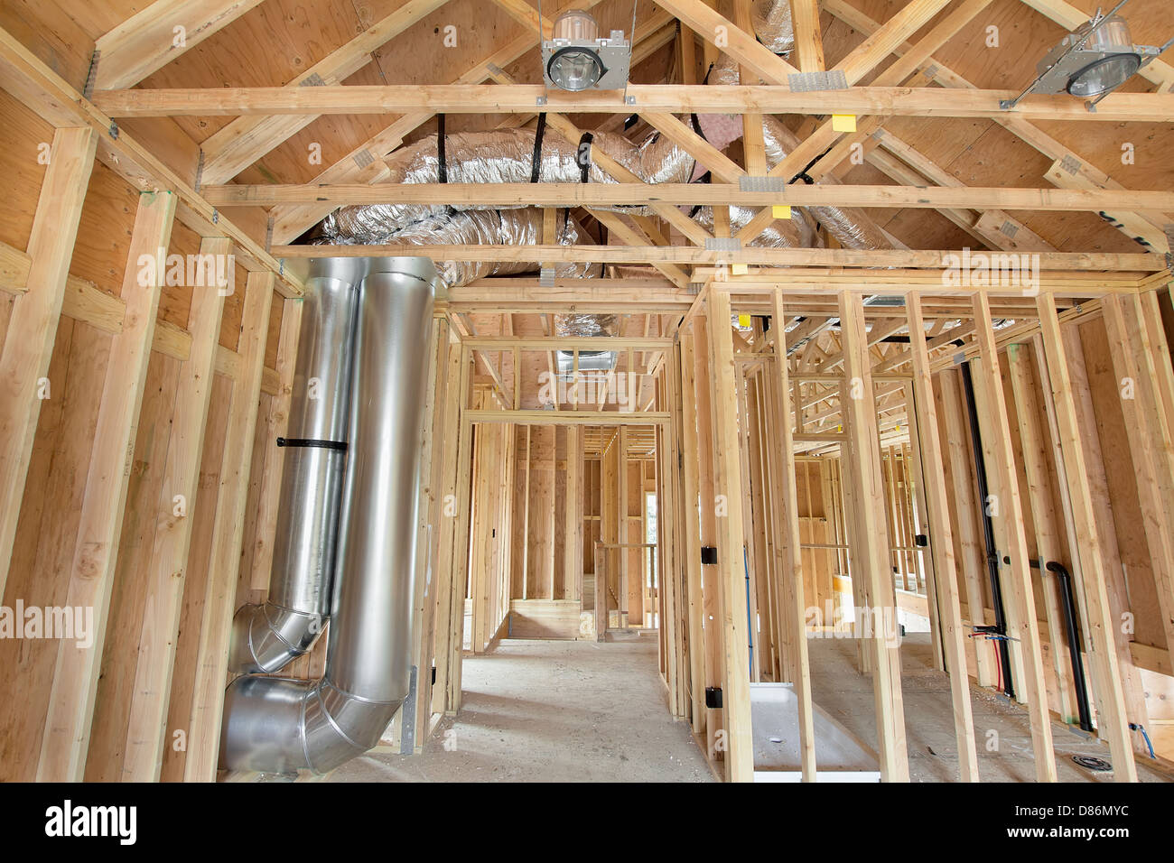 New Home Construction with Wood Studs Framing Heating Cooling System Air Duct Works Plumbing and Electrical Ceiling - Stock Image