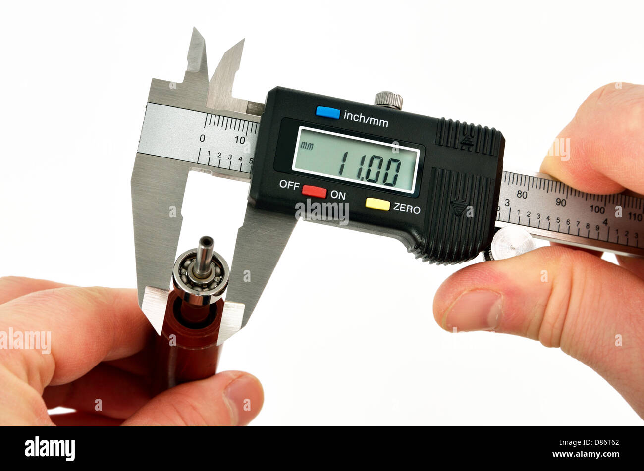 vernier caliper measurements on the bearing - Stock Image