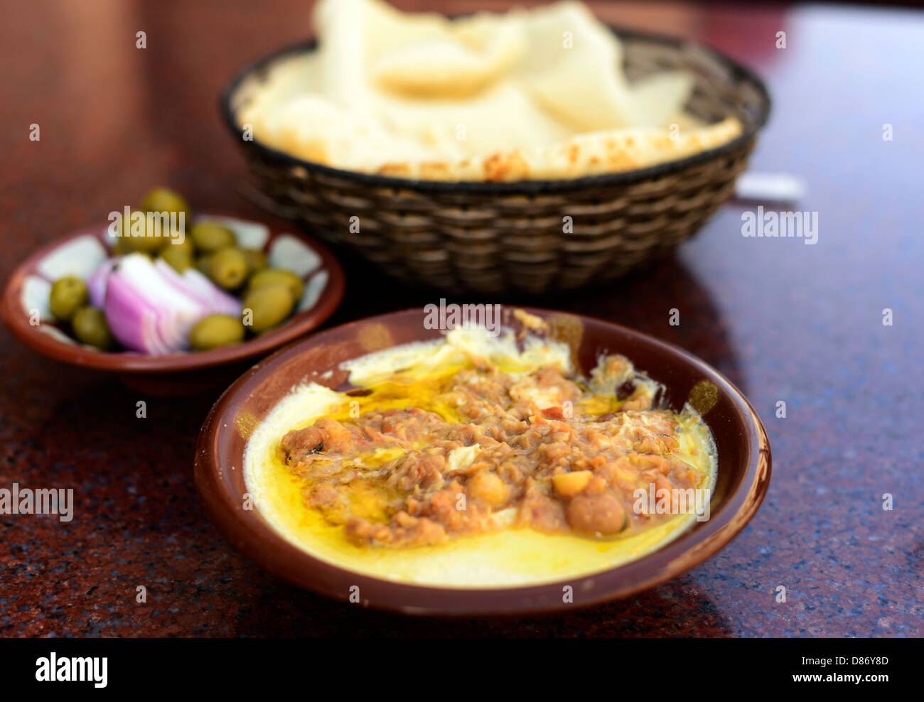 Hummus with Fuul ( Ful), a popular staple food in the middle east. - Stock Image