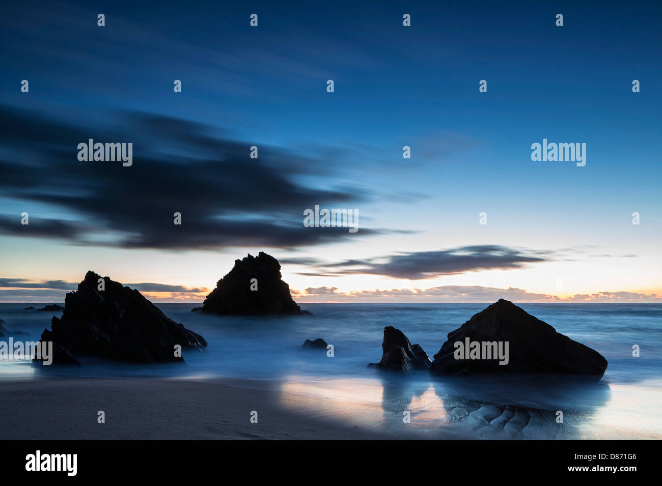 Portugal, View of Praia da Adraga at blue hour - Stock Image