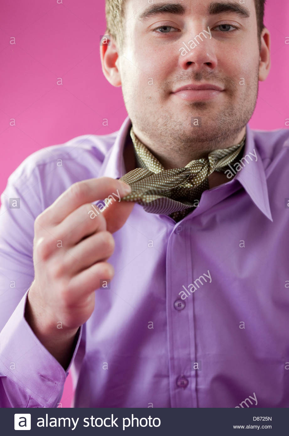 Close-up of a young man wearing a neckerchief of silk and smiling - Stock Image