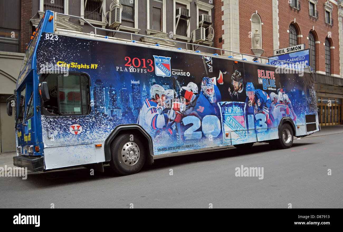 Tour bus in the  Manhattan theater district with an advertisement for the New York Rangers hockey team - Stock Image