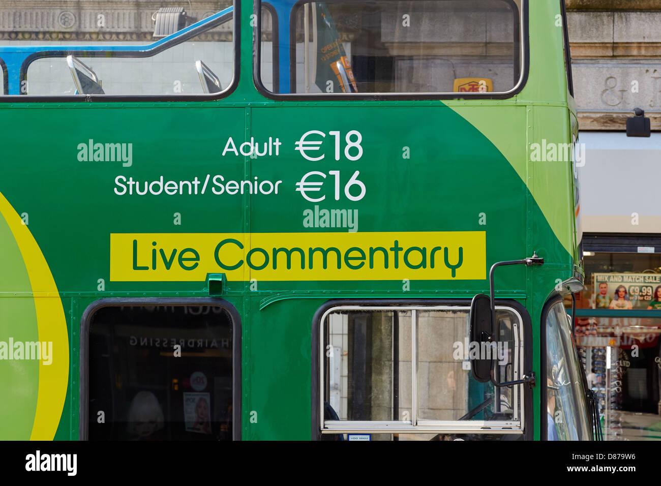 Dublin bus tour – Green bus – Hop on Hop off. O'Connell Street, Dublin, Republic of Ireland - Stock Image