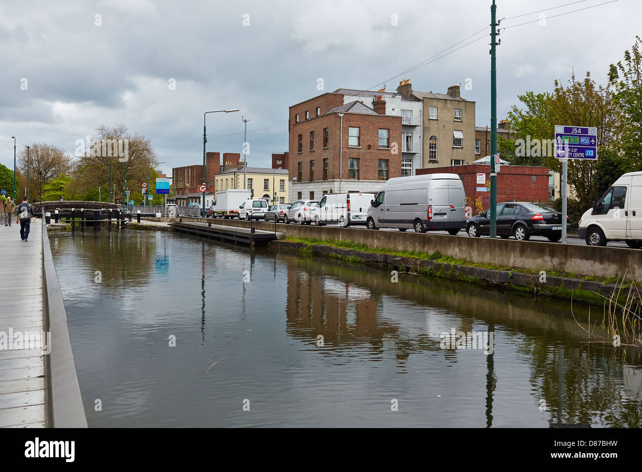 The Grand Canal Dublin showing traffic queuing along Canal Road on the way into the city centre. - Stock Image