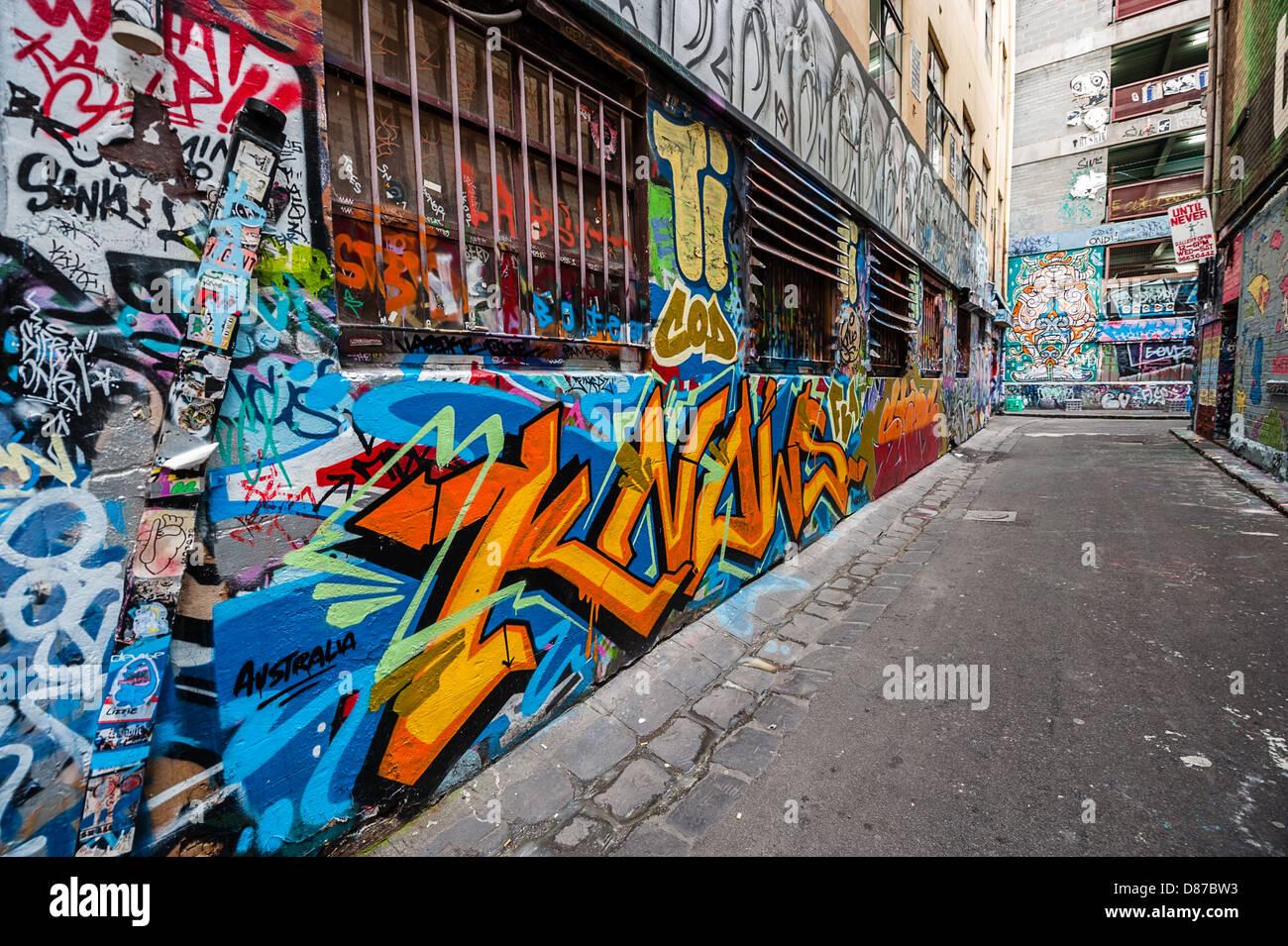 Melbourne's Hosier Lane is a celebrated landmark where legal street art decorates the walls. - Stock Image