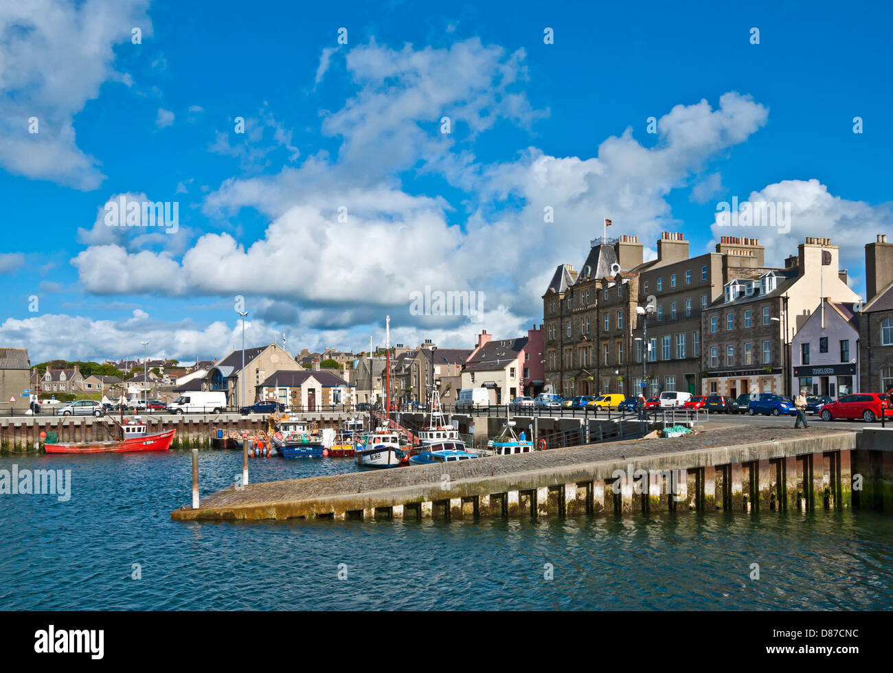Kirkwall Harbour Orkney Scotland with fishing and pleasure boats on a sunny June day with Kirkwall Hotel behind - Stock Image