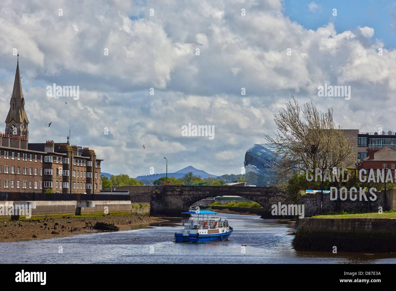 Pleasure cruiser on  the Grand Canal docks Dublin, with the Aviva Stadium in the background. Dublin, Ireland - Stock Image