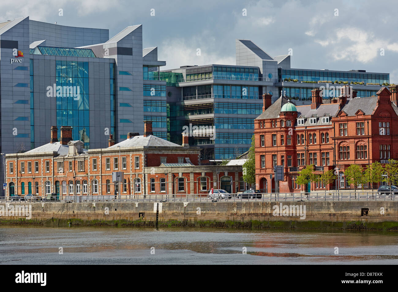 Old and new buildings sit side-by-side on North Wall Quay, Dublin Docks, Dublin, Ireland - Stock Image