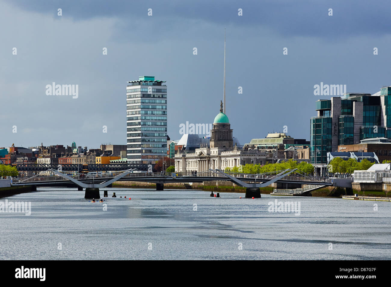 The River Liffey with the Custom House the Liberty Hall building and the Needle as landmarks on the Dublin skyline - Stock Image