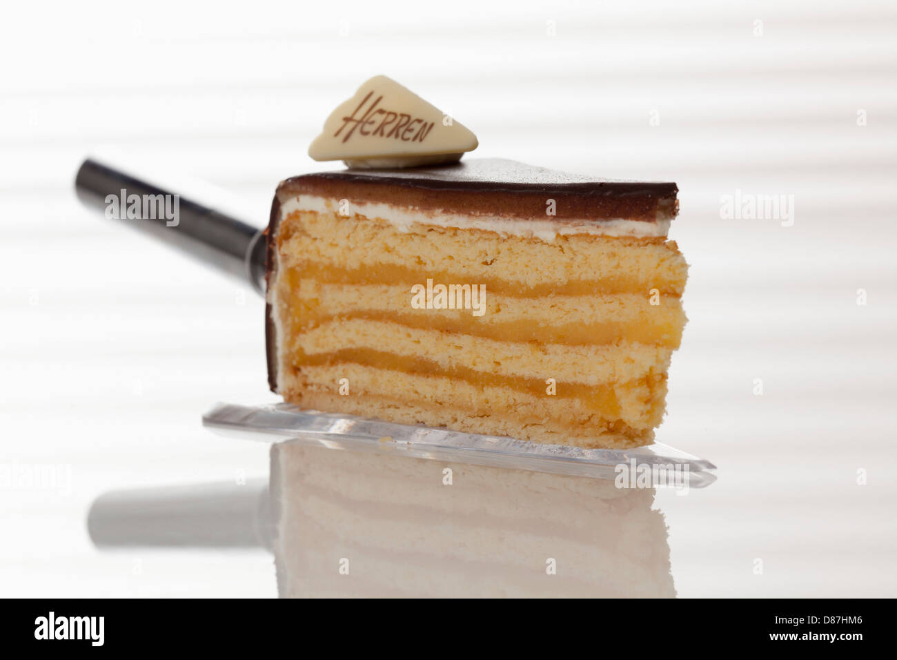 Slice of Herrentorte on cake server, close up - Stock Image