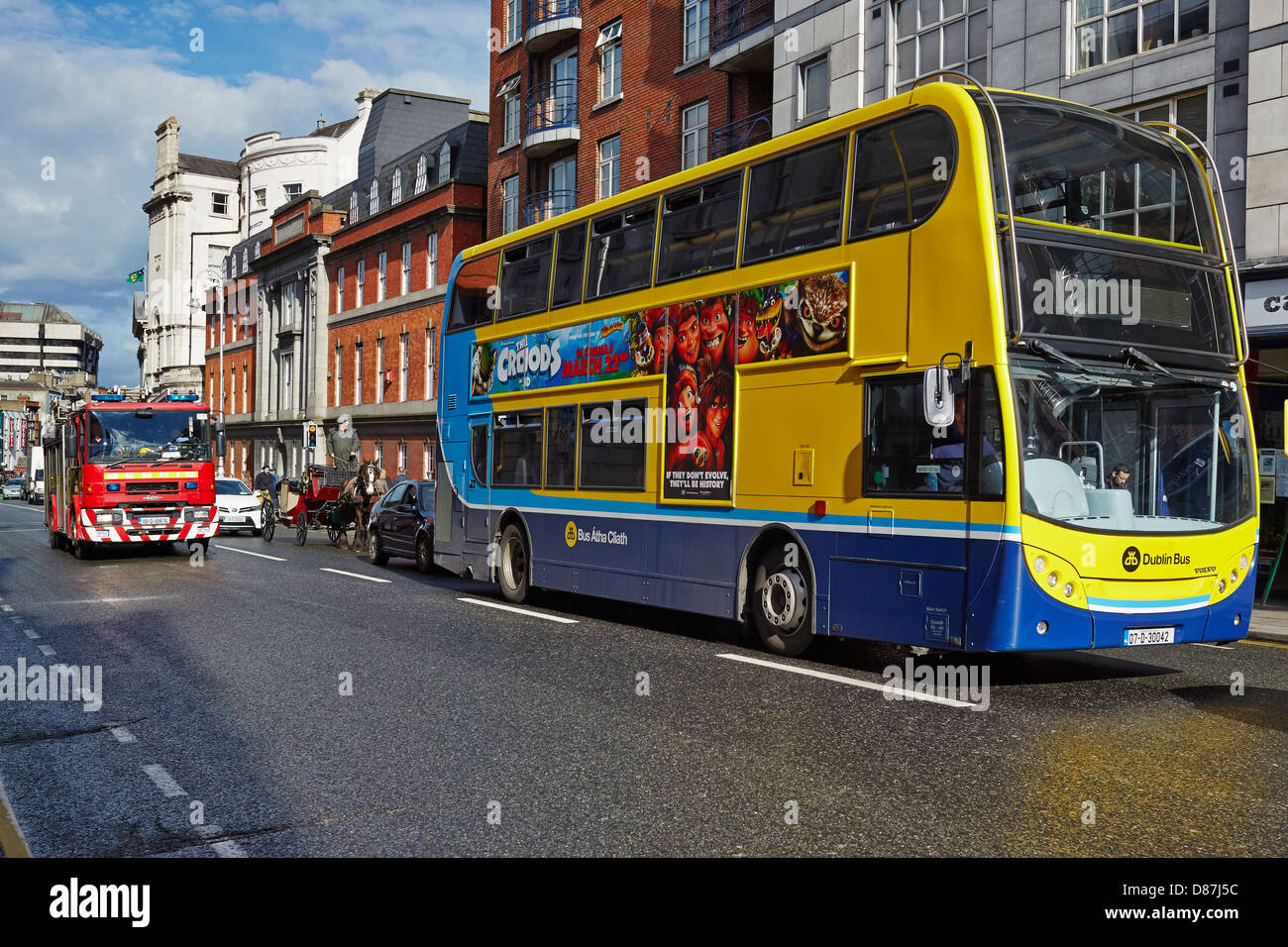 City bus, fire engine  and horse and carriage in a Dublin Street - Stock Image