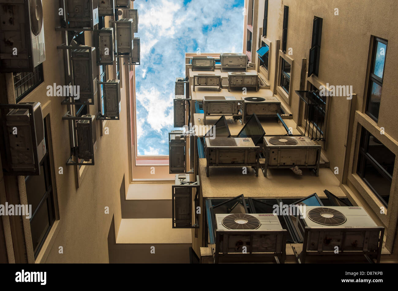Urban Mess - A lot of Air conditioner (aircon) in a housing building - Stock Image