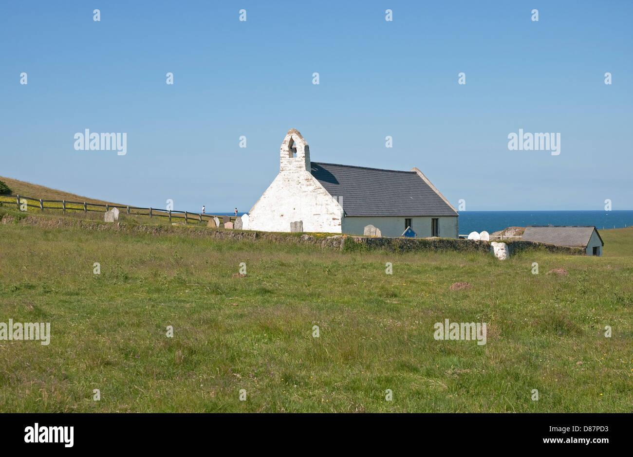 The isolated 14th century Holy Cross Church on the coast at Mwnt near Cardigan, Ceredigion, west Wales, United Kingdom Stock Photo