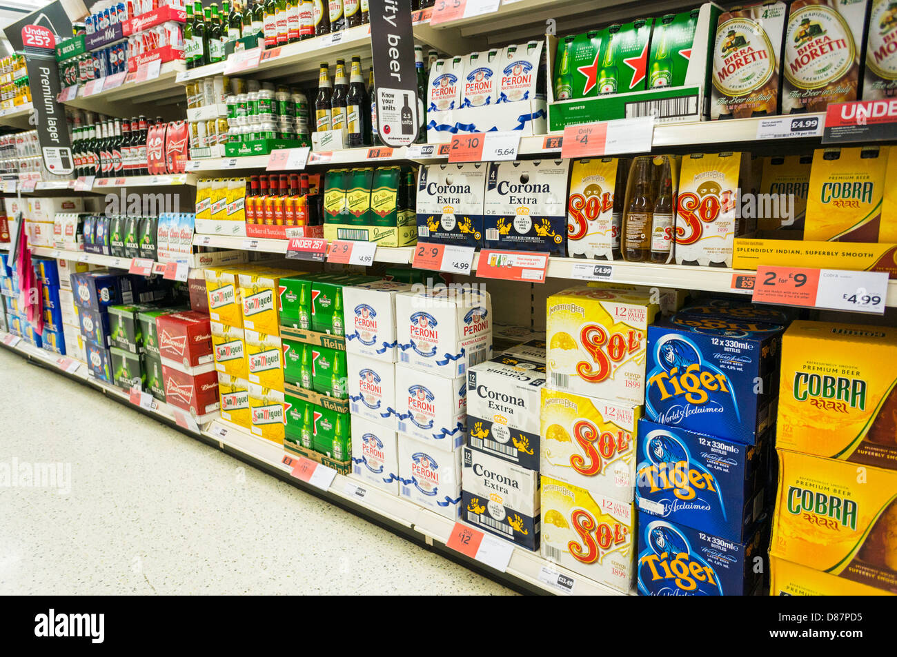 Lager / beer aisle in a Sainsburys supermarket, England, UK - Stock Image