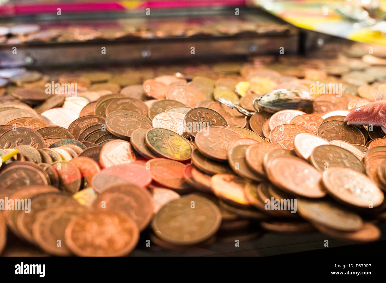Money - Piles of 2p pieces in an amusement arcade penny falls game, UK - Stock Image