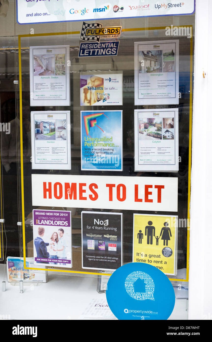 Homes to rent / let sign with rental houses properties in an estate agent window, UK - Stock Image