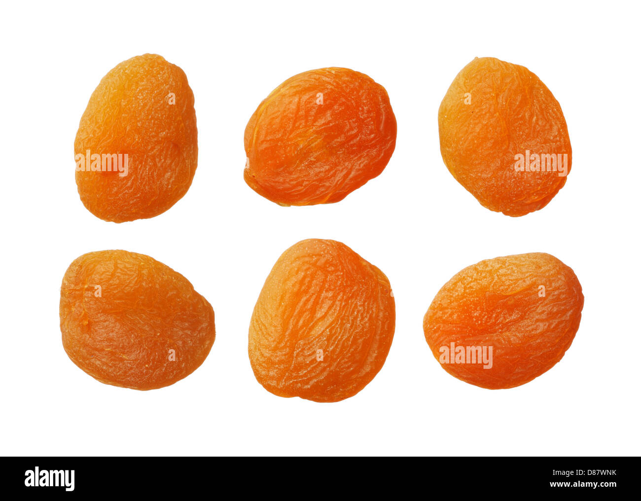 Dried apricots isolated on white background, close up - Stock Image