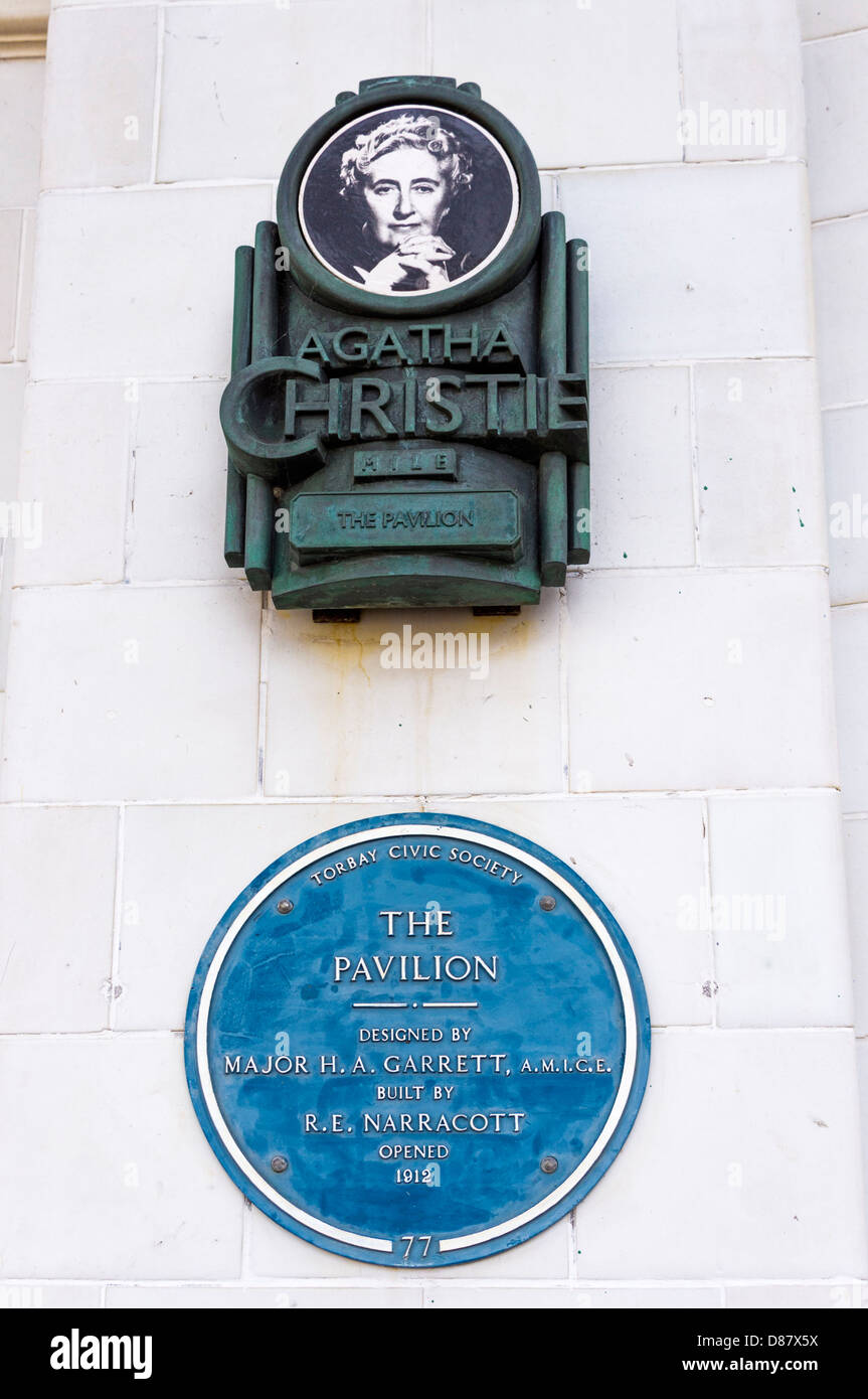 Blue plaque and Agatha Christie sign on the Pavilion in Torquay, Devon, UK - Stock Image