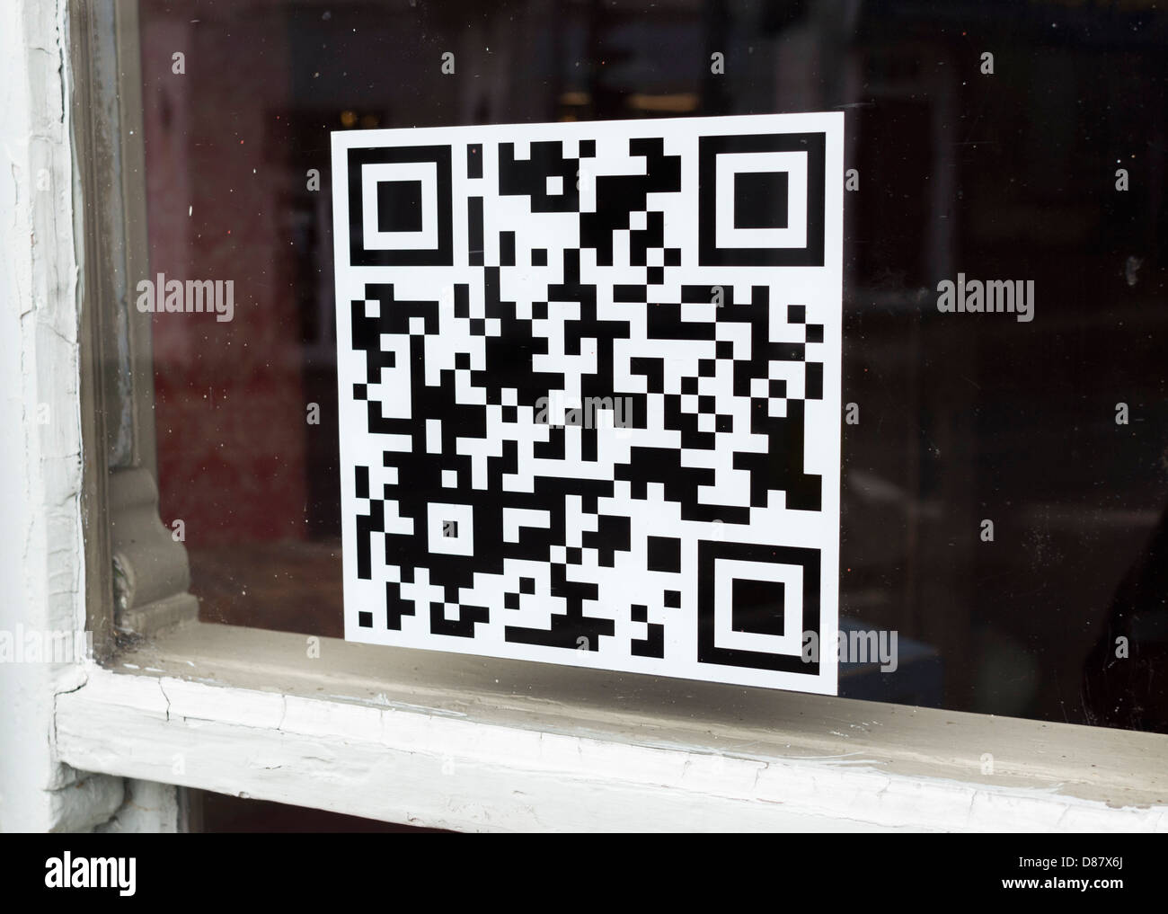QR code on a window of a shop - Stock Image